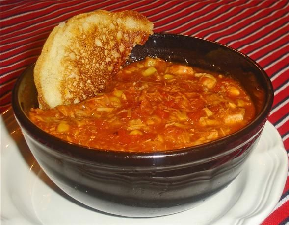 Traditional Brunswick Stew. My version: This is alot like the one I make except no bbq sauce and no mustard. I add 3 bay leafs, 1/4 c or so of apple cider vinegar, palm full of smoked paprika, tiny dash of cumin. I use four 1in thick slices of pork loin and 1-2 chicken breast. When meat is just done, I take it out and chop it up really good. I use whole kernnel corn instead of cream corn. My husband and the inlaws love it.