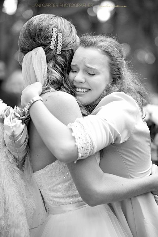 Bride being hugged at Wirreanda Park, Buderim. www.lanicarter.com