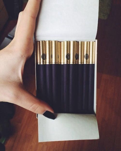 """Sobranie Black Russian. I wouldn't even smoke them - I would just stare at them and say """"Oooh, shiny!!!"""""""