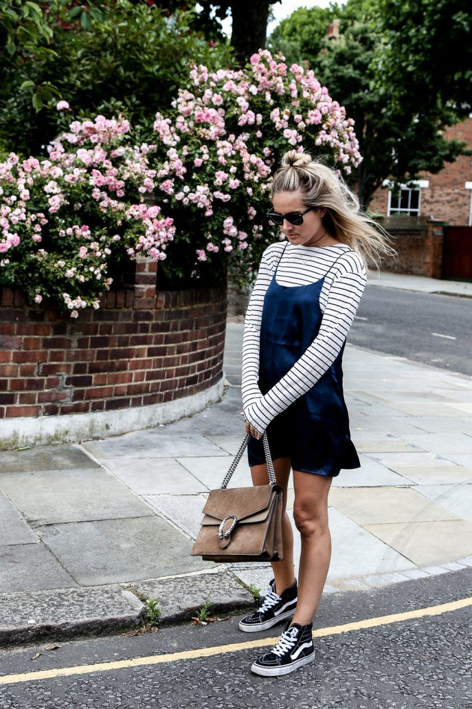 Wear a summer dress with a long sleeved top to get more wear out of it