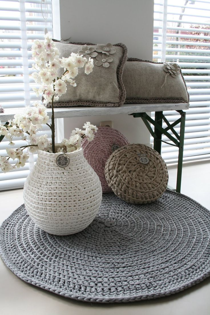 Crochet rug, vase and pillows