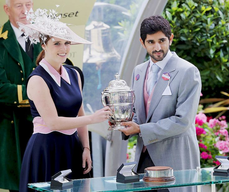 Princess Eugenie of York presents the trophy for the Tercentenary Stakes to Sheikh Hamdan Bin Rashid Al Maktoum on Day 3 of Royal Ascot on June 16, 2016.