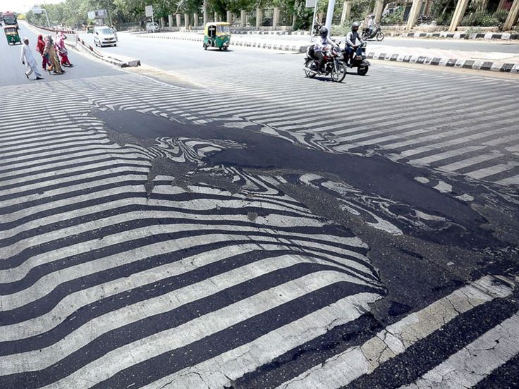 Summer Weather 2015 India Heat Wave Melting Roads  Temperatures are so hot---reaching as high as 122 degrees Fahrenheit in places like New Delhi---that roads have actually begun melting. Source: ABC