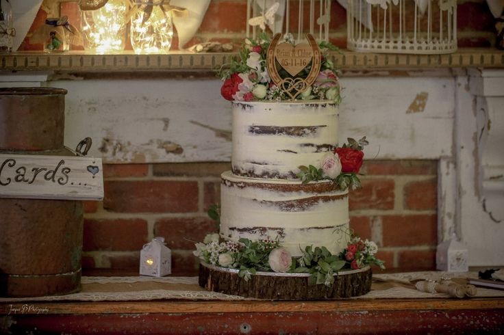 Here is a Semi Naked Cake with Flowers Matching the Brides flowers, The wedding was at the amazing Log Cabin Ranch,