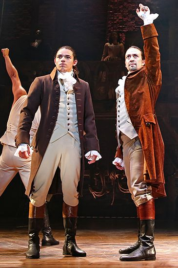 "Anthony Ramos (front, left), one of the stars of the Broadway musical ""Hamilton,"" on stage with actor Lin-Manuel Miranda during a performance."