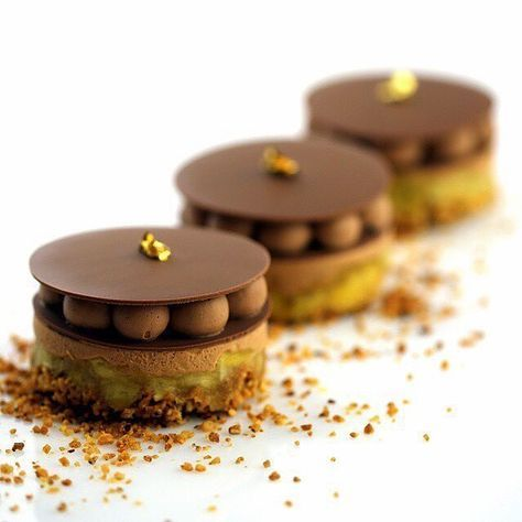 #ValrhonaUSA #Bestof2016 - This Hazelnut streusel, Caramelized banana , Valrhona CARAMELIA 36% mousse and Gianduja whipped ganache by Pastry Chef Nicolas Blouin (@nikro31) of Mansion on Turtle Creek (@rwmansionturtlecreek) is one of your 2016 favorite creation! Who wouldn't love it?!