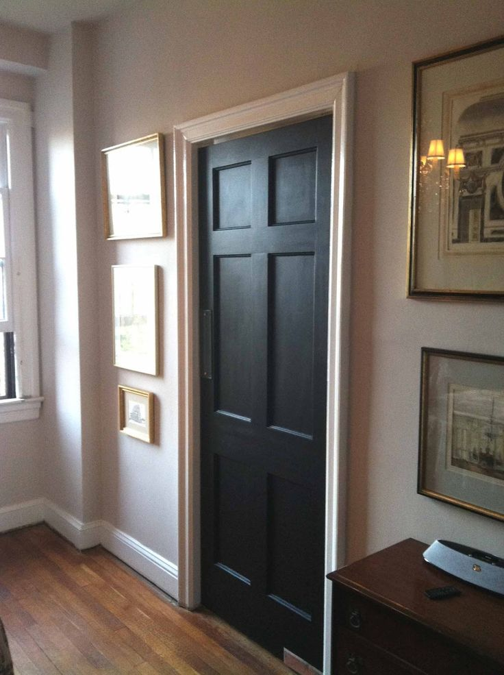 black interior doors - I have them in the current house, will def be doing this for the new house. Easy way to add class.