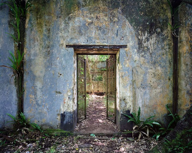 First building of reclusion -1897-, entry, Penal colony, Guyana  by Thomas Jorion