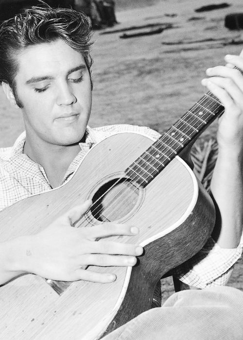 """Elvis Presley on the set of """"Love Me Tender""""... so young and beautiful... love his eyelashes in this picture!"""