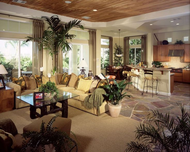 Tropical Great Room with Fabric curtain, Belleforte barstool, Sectional sofa, Built-in bookshelf, Indoor plant, Pendant Light