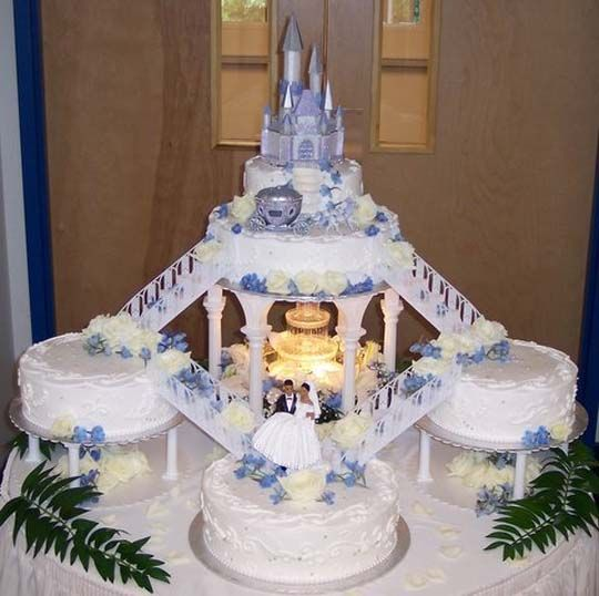 THE BRIDES CAKE! :) ONLY CHANGE THE COLOR OF THE CASTLE AND CARRIAGE AND FLOWERS TO BLUE AND REMOVE THE LEAVES AND PUT SNOW FLAKES! :)