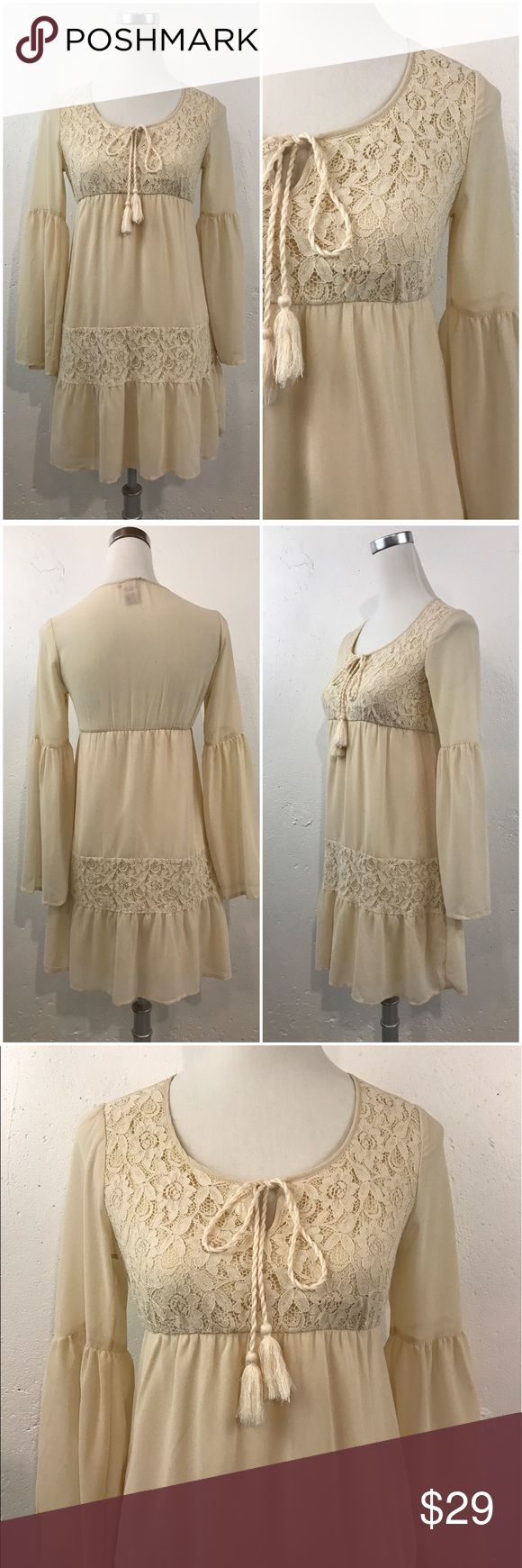 """<Flying Tomato> Cream Boho Bell Sleeve Dress Beautiful bohemian-festival style dress! The waist is elastic. Armpit to armpit 15"""", waist 12"""" with stretch to about 17"""", hips approx. 17"""" flat, length 32"""". There is a small discoloration on one shoulder. This dress is lined and the material is a chiffon polyester. Flying Tomato Dresses Mini"""