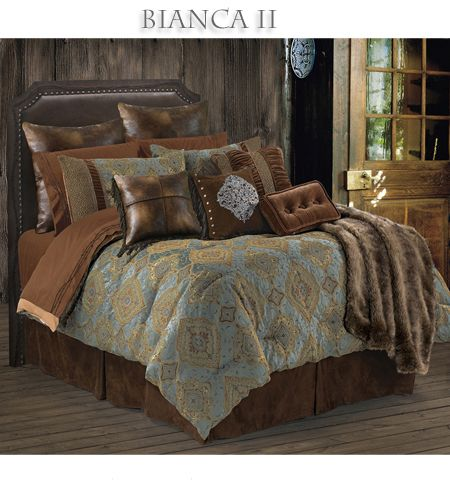 Bianca II #Southwestern #Bedding - Southwestern bed in a bag comforter set features a elegant blue brown and gold comforter set against a rich chocolate brown micro suede bedskirt. Two tone pieced shams, velvet accents and hand stitched cross design fringed faux leather pillow and dark faux leather euro shams completing the true elegance of a #southwestern #decor. #BeddingNMore #Southwestern #Home #Bedroom #Decor