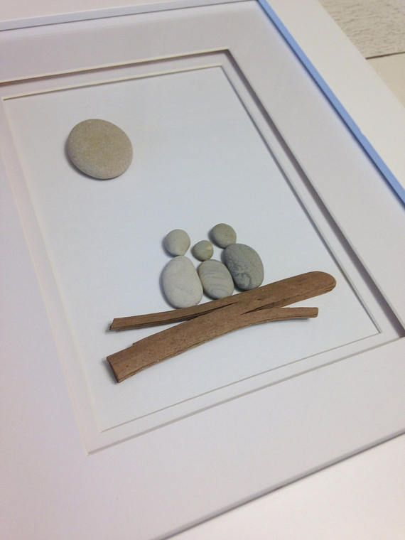 This unique Family of Three Pebble Art piece was made from gatherings our family has made along the shores of Lake Huron, Ontario, Canada. The full framed size is 10 x 12 and can hang on a wall or stand on its own. This piece is truly one of a kind