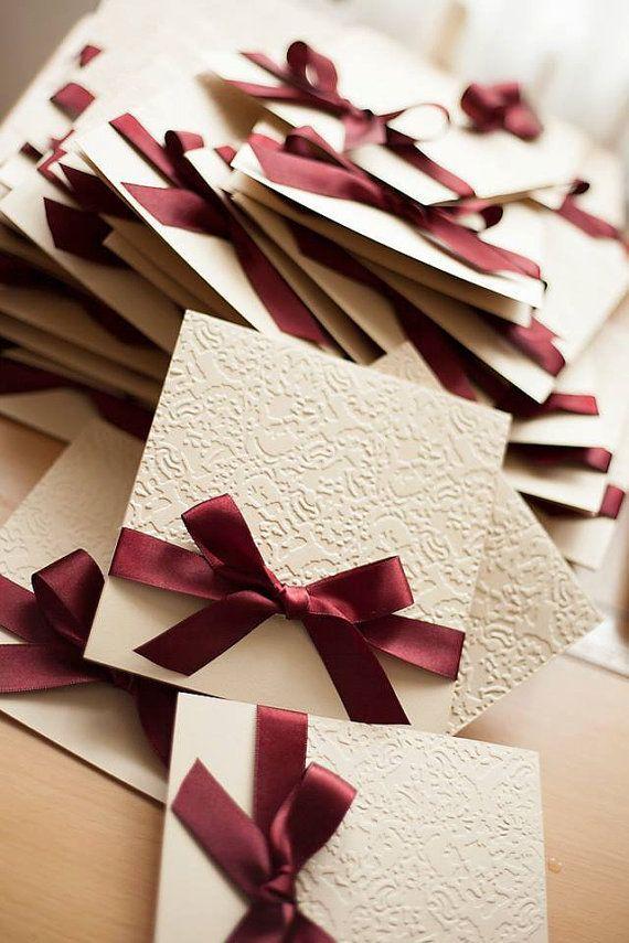 Classic bow wedding invitation. Embossed by YellowBirdWedding
