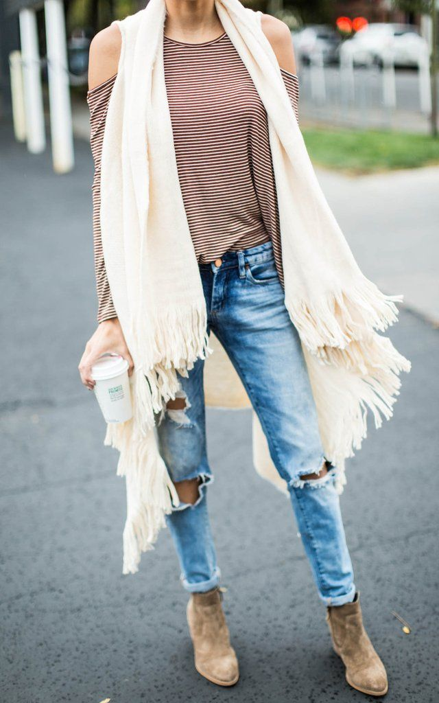 Long layers with a touch of boho are this seasons vibe. Our Ivory Fringe Sweater Vest is the coolest layer features an open vest and fringe details on the hem. Pair our Ivory Fringe Sweater Vest with