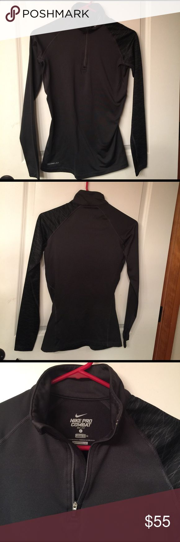 Women's Nike pro combat dri-fit jacket size small Women's Nike pro combat dri-fit jacket size small charcoal grey. One sleeve printed EUC. Fitted with thumb holes. Nike Jackets & Coats
