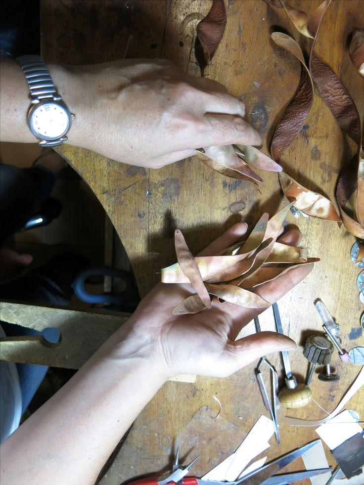 Work in progress on the bench. Copper enamel seedpods. Autumn 2016