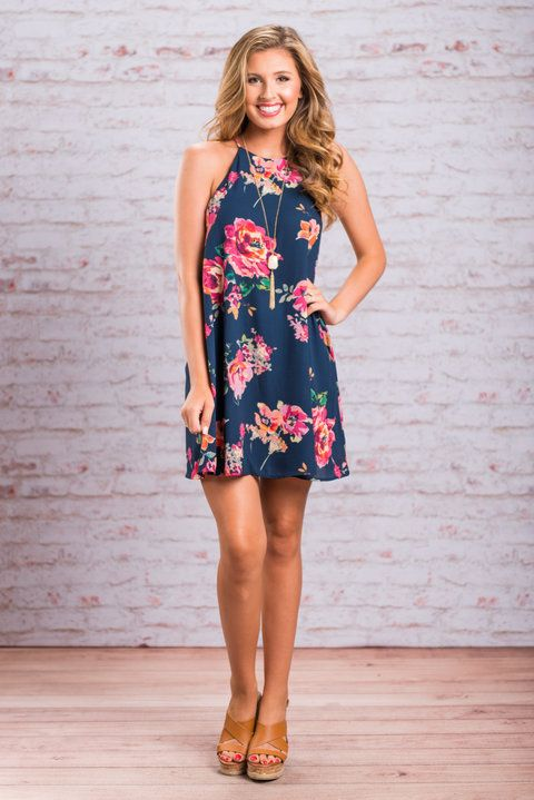 This dress is both bright and blissful! Those vibrant flowers leap right off that dark navy background! We love the classic shift cut too! It makes it so easy for different body shapes to wear! This dress is fully lined to keep the top layer from being sheer! And all of this together makes us truly blissful!