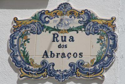 Portuguese Tiled Street Sign - Rua dos Abraços, which  literally means the Street of Hugs. Armação de Pêra, Algarve. Portugal