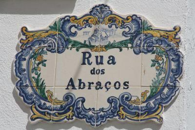 Portuguese Tiled Street Sign - Rua dos Abraços, which  literally means the Street of Hugs. Armação de Pêra, Algarve. Portugal