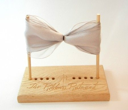 Ask Dad to make me one of these bow maker blocks...very simple to take a block of wood, drill some holes & cut down a wooden dowel