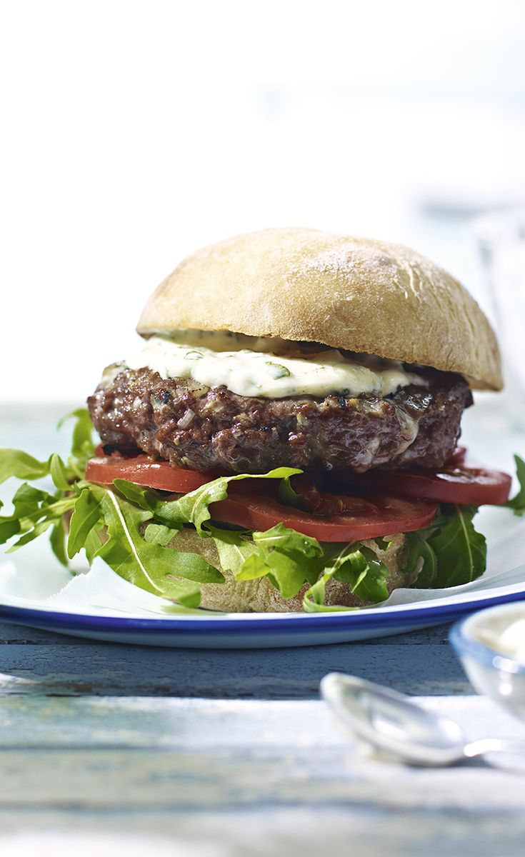 Liven-up your usual beef burger with our recipe for Italian-style burgers with fresh basil dressing. Find more barbecue recipes on the Waitrose website.