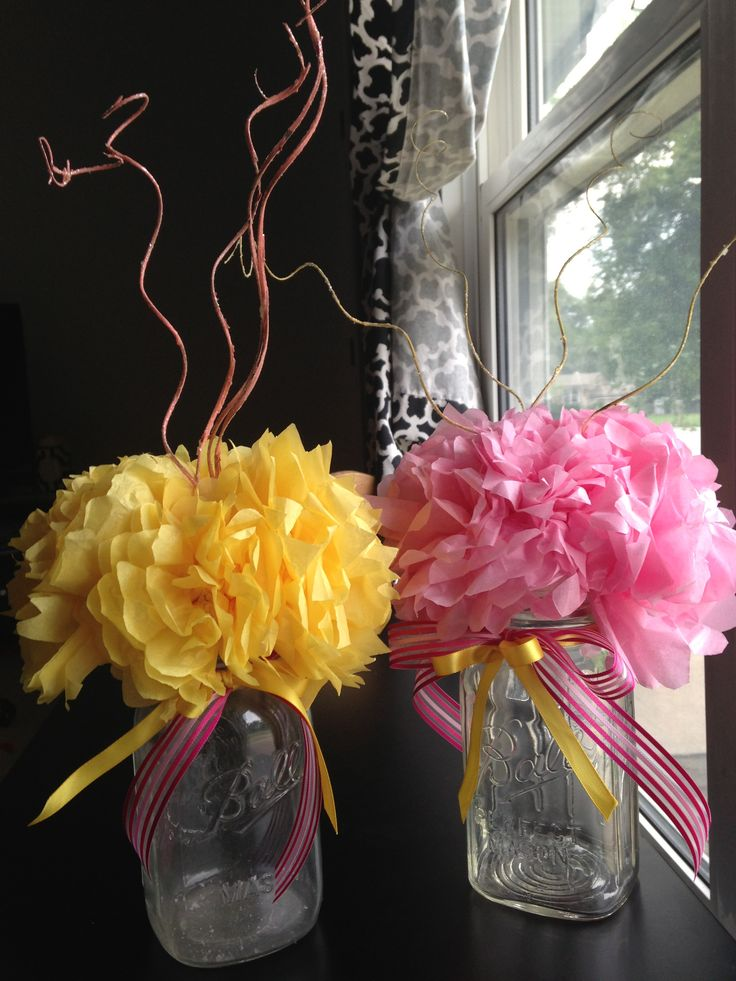 Easy tissue flowers pinned into styrofoam and set on top of Ball Mason Jars. Fill them with slices of lemons and water and you got an inexpensive centerpiece.