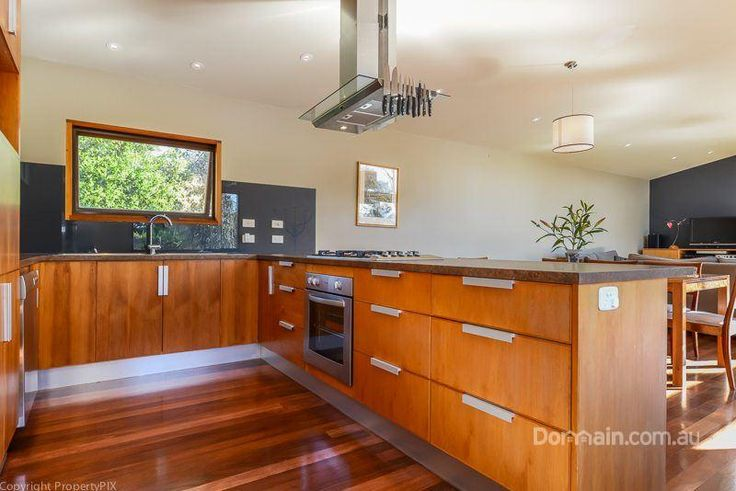Celery-topped pine kitchen under white raked ceiling, black backsplash & stainless accents - polished Jarrah floorboards... South Arm, Tas Oct'14