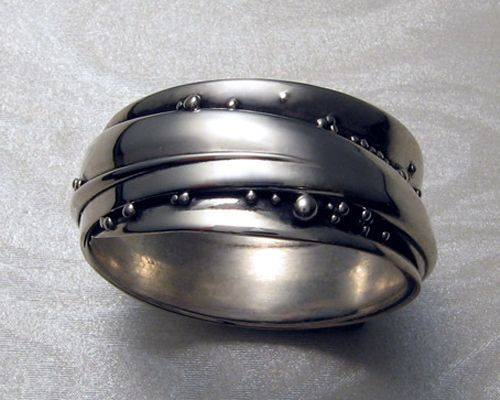 Wedding Bands - Metamorphosis Jewelry  www.metamorphosisjewelry.com One of Toronto's top contemporary jewelry designers, James Morton specializes in creating, unique wedding bands and unusual wedding ring sets.