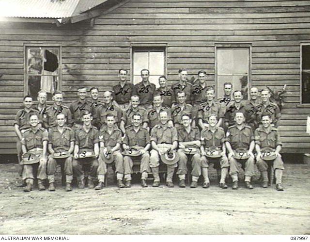 Group portrait of Battalion Headquarters Personnel 2/48th Battalion. Identified: QX17407 Sergeant (Sgt) W W Jolly (1); WX12006 Corporal (Cpl) E E Webb (2); QX53659 Lance Corporal (LCpl) S Silk (3); ...