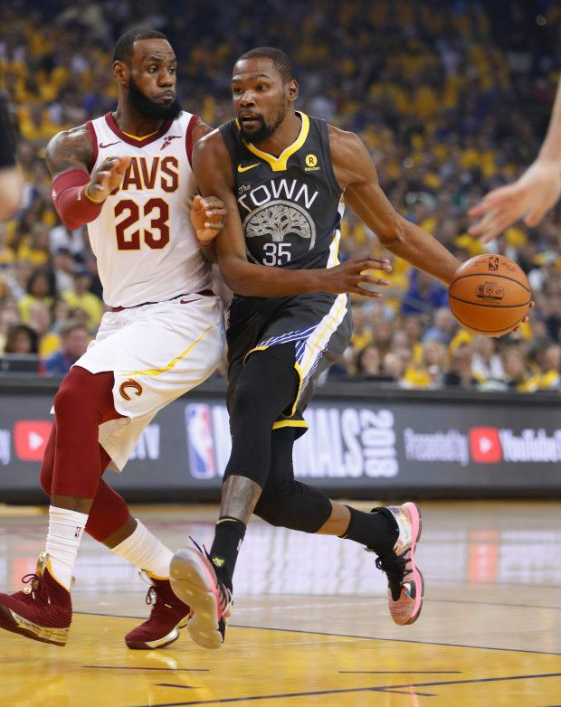 6b56b52b421d1 Golden State Warriors  Kevin Durant (35) heads to the basket against  Cleveland Cavaliers  LeBron James (23) in the first quarter of Game 2 of  the NBA Finals ...