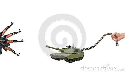 Man holds on an iron chain military tank, avoiding conflict against weapons