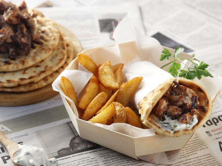 Homemade Greek pork gyros! Traditional, aromatic, pork gyros, served with tzatziki sauce, bagels and sweet potato chips!