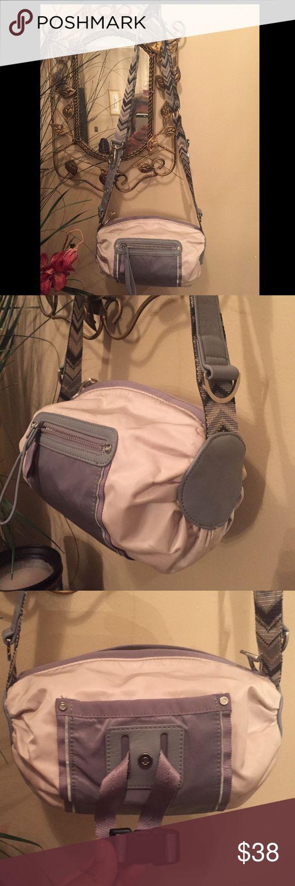 LULULEMON BAG Pre-owned LULULEMON Bag. Gray/bone color. Zipper closure, mesh pocket inside, pocket located in front and back. Adjustable strap. Slight exterior wear, though bag in great condition. lululemon athletica Bags Crossbody Bags