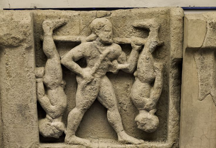 Heracles and the Cercopes. Sandstone. Metope from the temple of Hera at the mouth of the river Sele. Mid-6th century B.C.Paestum, National Archaeological Museum.