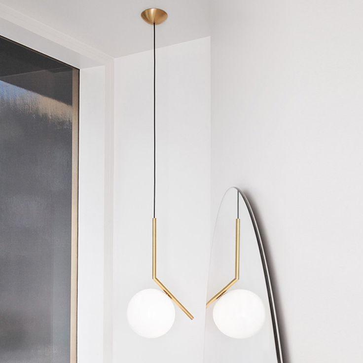 Order the ic pendant lamp with the voluminous light body designed by michael anastassiades for flos in the interior design shop