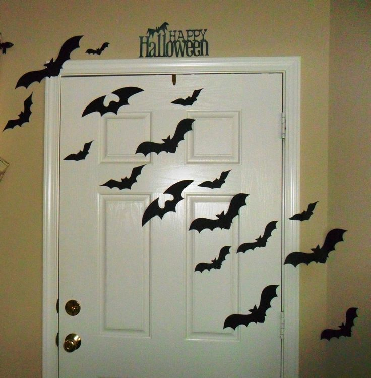 Halloween Door Decorating Kit with Bats, Witch's Shoe, and Spooky Happy Halloween Phrases. $24.99, via Etsy.