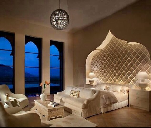 moroccan inspired bedroom with spectacular detail on focal wall behind bed