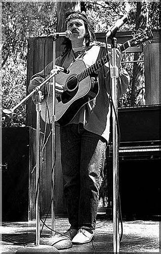 WOODSTOCK 1969 Country Joe and the Fish.  I,2.3,4 what are we fight for?  I don't give a dam, next stop is Vietnam.