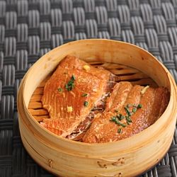 Salmon fillets smoked in a bamboo steamer using tea leaves.  An easy way to add a different flavor to your salmon.