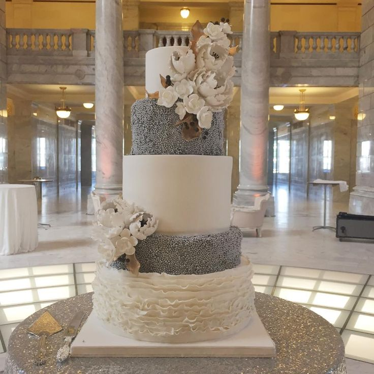 AMAZING cake table. We love the fresh and clean look to this, the silver sequin table linens really make this table pop. @Michelleleoevents www.creativecoverings.com