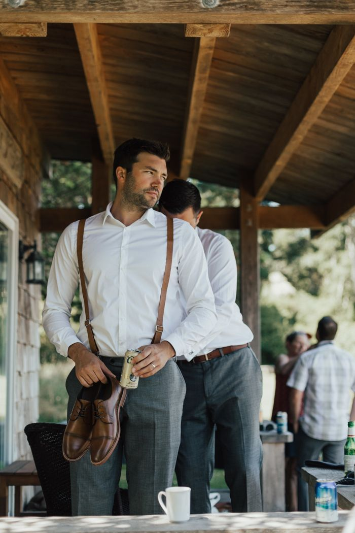 A crisp white shirt, leather suspenders and grey trousers makes for a classical handsome groom | image by Nomad by NK  #groom #groomstyle #groomportrait #groomattire #groomapparel #groominspo #groominspiration
