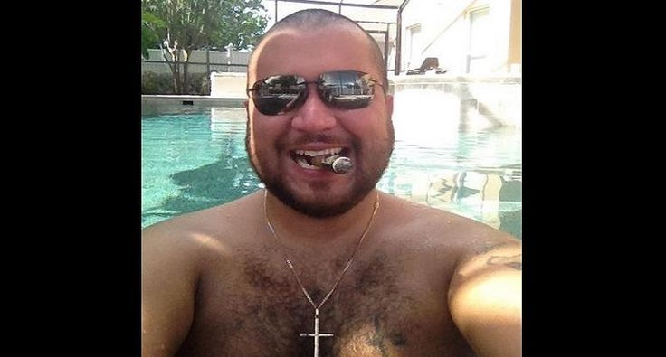 George Zimmerman is the pathetic waste of skin that murdered Trayvon Martin in Feb. 2012, arguably the first high-profile killing of an innocent black man in modern day America. Since then, he's assaulted and threatened several more people, including his ex-wife and girlfriend. He has a mug shot for every day of the week. And now, the evil, arrogant fuckhead decided it was a good idea to tweet a picture of Trayvon Martin's dead body for all to see. Pixelated but still disturbing.