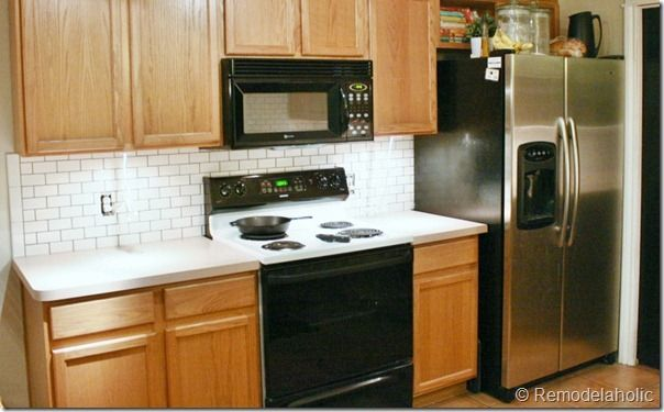 See how we installed a white subway tile back splash in our kitchen, to give it a nice custom updated look.