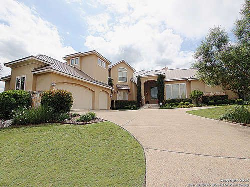 Single Family Detached - San Antonio, TX Gorgeous 2-story Mediterranean-style home in the Dominion featuring many luxury appointments located at the end of a cul-de-sac featuring an open floor plan, chef grade kitchen, large covered patio for entertaining, shutters throughout, custom cabinetry, built-in stereo system, domed ceilings in master and living areas, granite countertops, soaring ceilings, bar with ice maker, and two large pantries.  Master bath has a whirlpool tub & large shower…