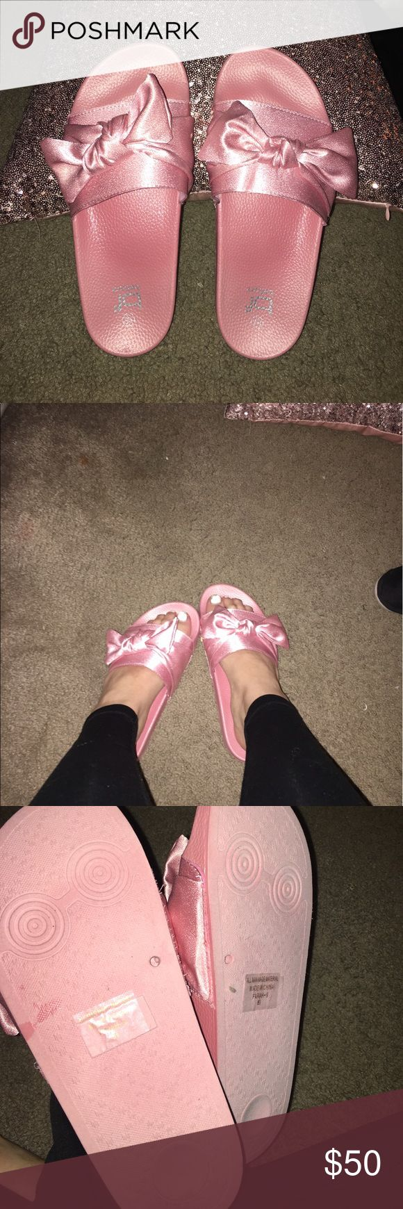 Satin pink bow slides Got from a boutique because I missed the Rihanna slides :( but very cute nonetheless, amazing thick quality puma for exposure Puma Shoes Sandals