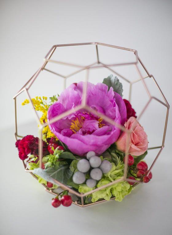 Geometric terrariums hold vibrant floral arrangements. Wedding Planner: SoCal Wedding Consultant.