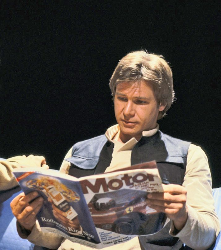 Always trying to figure out ways to make the Millennium Falcon go FASTER, Han Solo reads a MOTOR Magazine article about the Brazilian Grand Prix.