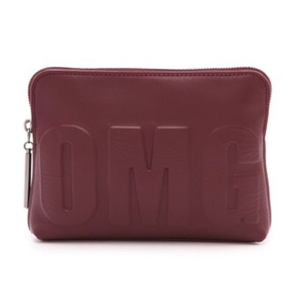 3.1 Phillip Lim 31 Second OMG Pouch Embossed 'OMG' lettering energizes a soft leather 3.1 Phillip Lim bag. 6 inches (height) by 8.25 inches (width) by 2 inches (deep). 3.1 Phillip Lim Bags